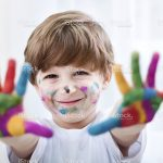 stock-photo-70080125-smiling-beautiful-child-playing-with-colors